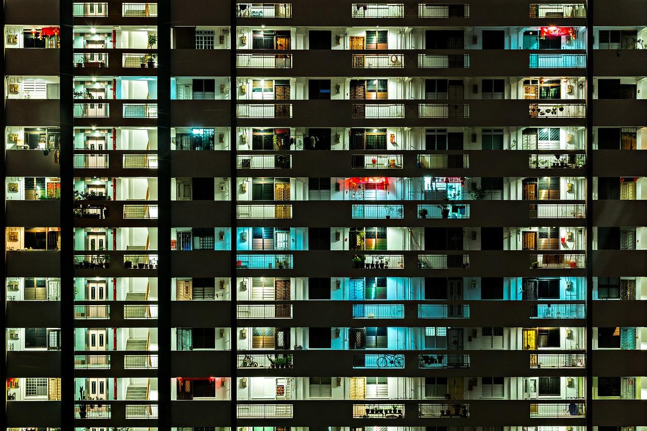 Frontal view of HDB common corridor flats at night